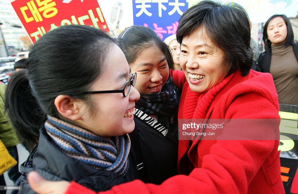 A teacher cheers on her students taking the College Scholastic Ability Test at a school on November 13, 2008 in Seoul, South Korea. More than 580,000 high school seniors and graduates sit for the examinations at 996 test centers across the country. Success in the exam enables students to study at Korea's top universities.