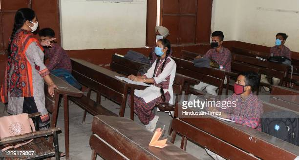 Teacher conducts a class after schools partially reopened during coronavirus outbreak, at Government Civil Lines School, on October 19, 2020 in...