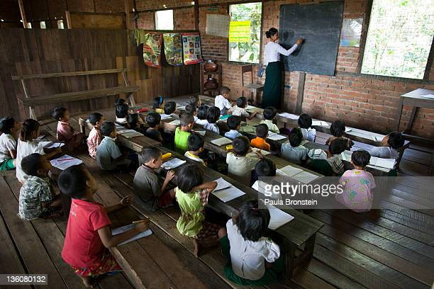 A teacher conducts a class at a small government run school December 14 2011 in Waw township Myanmar The education system is based on the United...