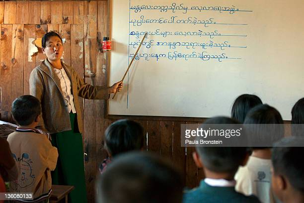 A teacher conducts the class at a government run school December 16 2011 on Inle Lake Myanmar The education system is based on the United Kingdom's...