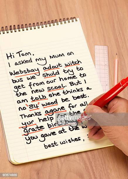 teacher correcting dyslexic child's letter. - spelling stock pictures, royalty-free photos & images