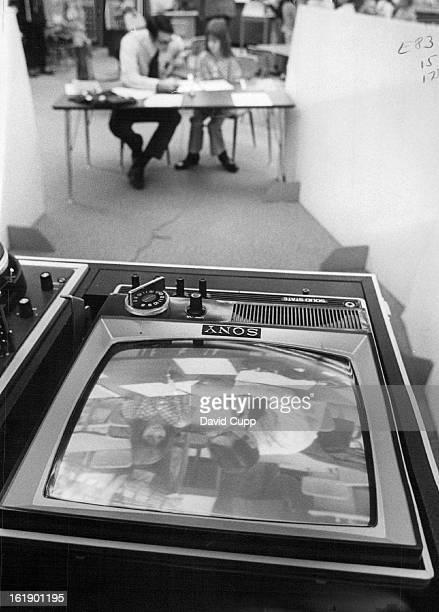 NOV 17 1971 NOV 20 1971 NOV 25 1971 Teacher David Mast and student Trisha Morris whose images appear on TV screen use video tape for selfevaluation...