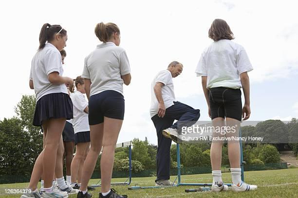 Teacher demonstrating hurdles
