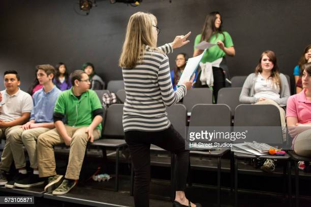 Teacher directing students in drama class