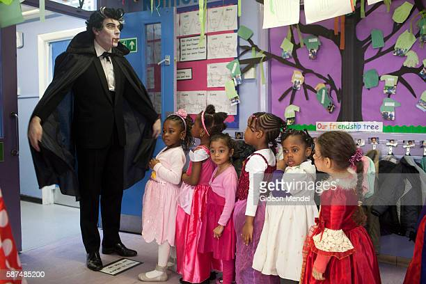 A teacher dressed as Dracula has his nursery class line up to at Kingsmead Primary School in Hackney on World Book Day when staff and pupils had been...