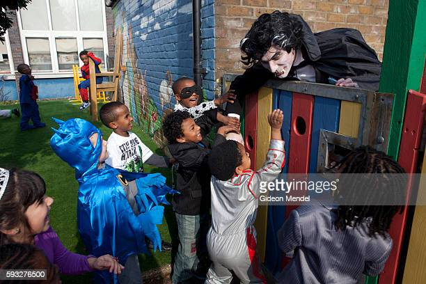A teacher dressed as Dracula playfully scares some pupils at Kingsmead Primary School in Hackney on World Book Day when staff and pupils had been...