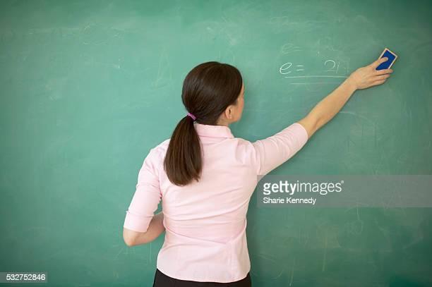 Teacher Erasing Blackboard