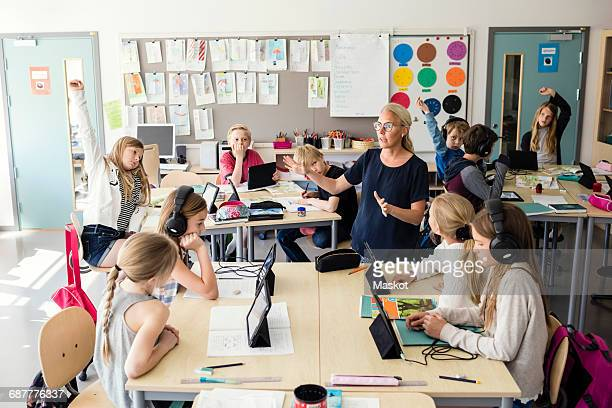 Teacher explaining in classroom