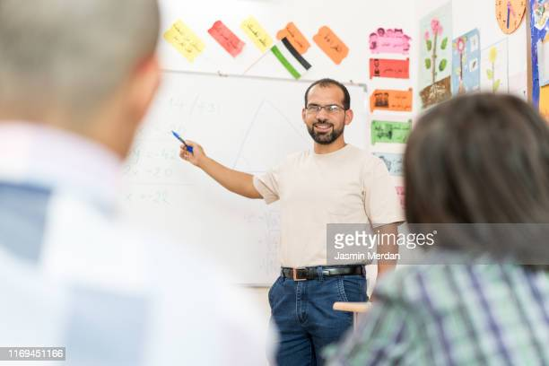 teacher explaining lesson to students - jordanian workforce stock pictures, royalty-free photos & images