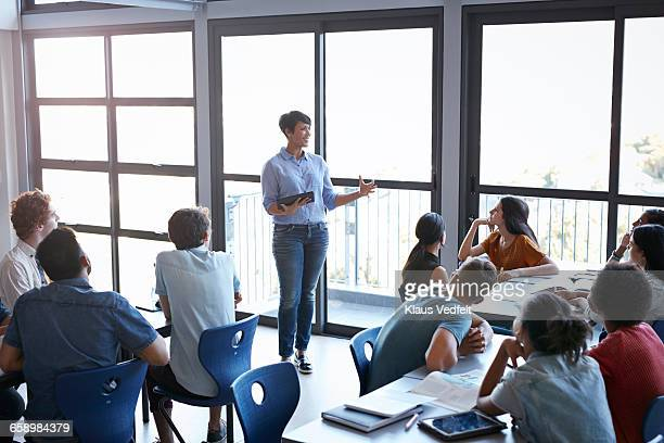 Teacher explaining to students in classroom