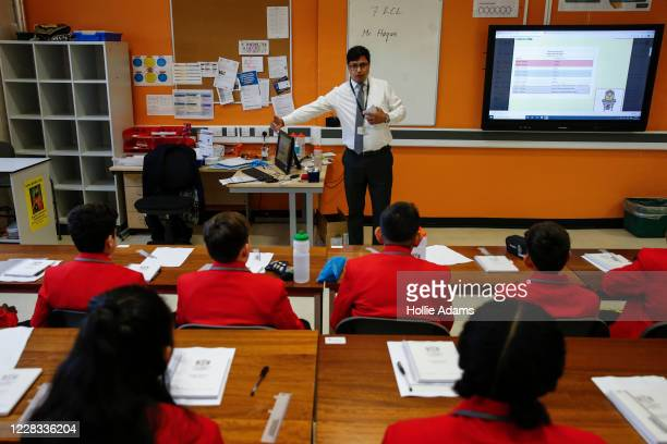 Teacher explains social distancing measures to a group of year 7 students in a classroom at City of London Academy Highgate Hill on September 4, 2020...