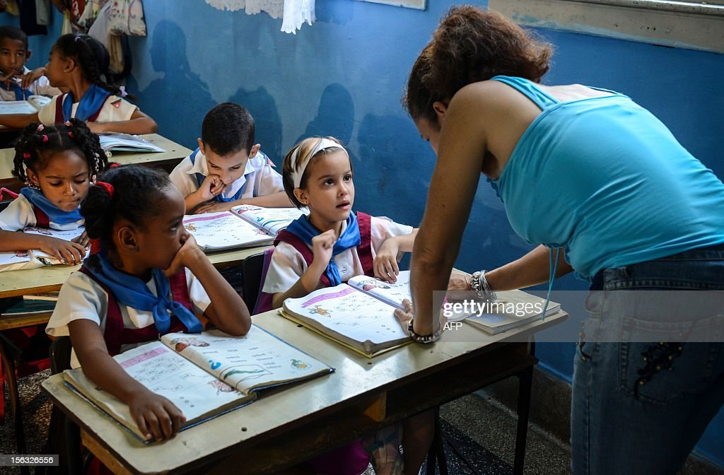 A teacher explains the lesson to her pupils, at a school in Havana on November 13, 2012.