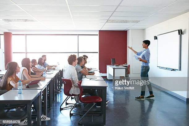 Teacher explaning to students in classroom