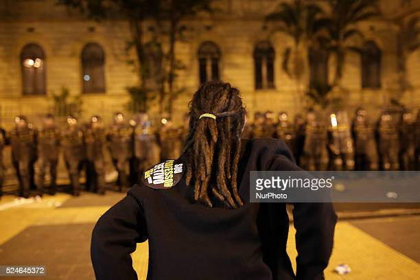 A teacher faces a line of riot police in front the State's Department of Education during a protest of the teacher of the State of Sao Paulo that are...