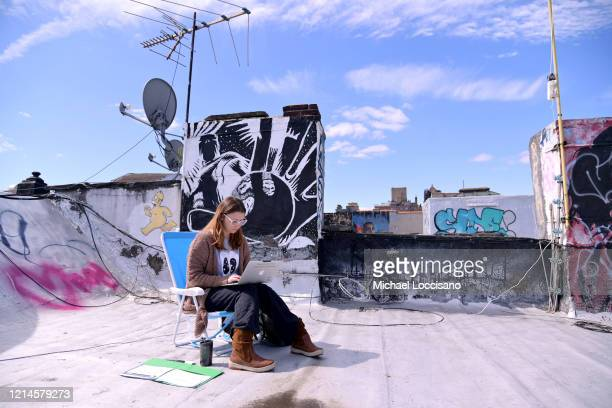 A teacher from Yung Wing School PS 124 who wished not be identified remote teaches on her laptop from her roof on March 24 2020 in New York City Due...