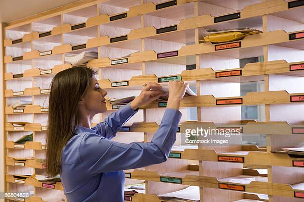 teacher getting her mail - post structure stock pictures, royalty-free photos & images