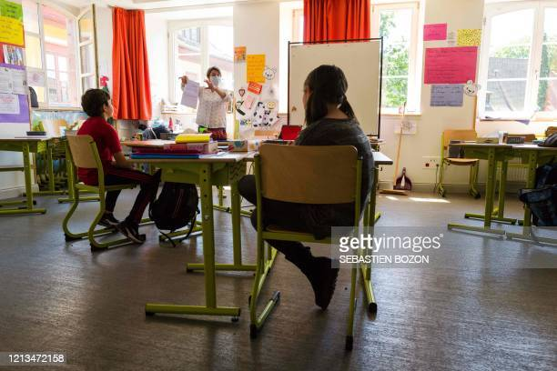 A teacher gives a lesson at the Cour de Lorraine elementary school in Mulhouse eastern France on its reopening day for pupils on May 18 as France...