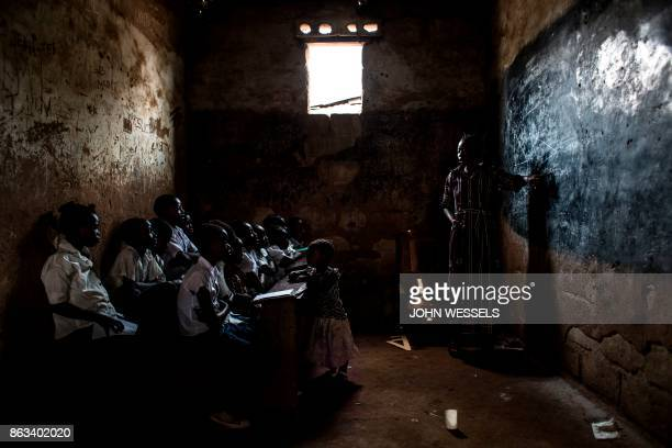 TOPSHOT A teacher gives a math class at a school which assists with integrating former child soldiers who were affiliated with the local...
