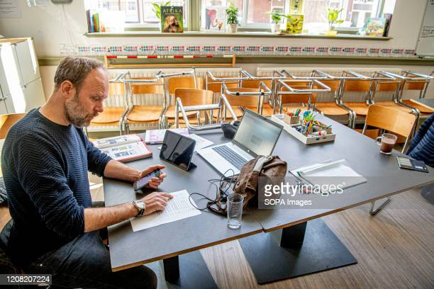 A teacher gives digital classes at his empty Globettroter school in Rotterdam The Dutch government has order all schools to be closed until further...