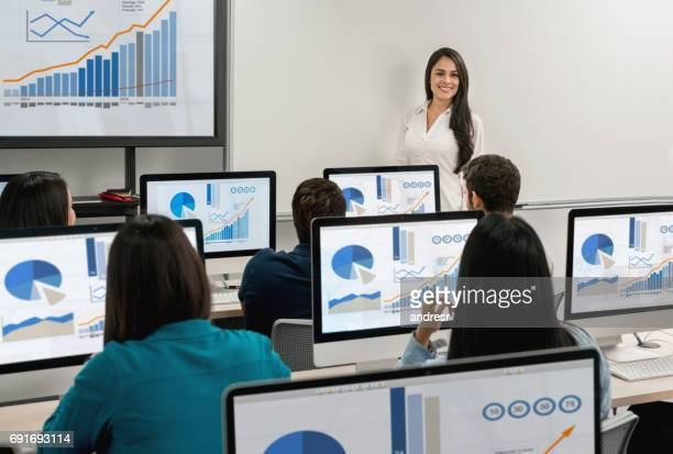 teacher giving a class at the it room - computer lab stock pictures, royalty-free photos & images