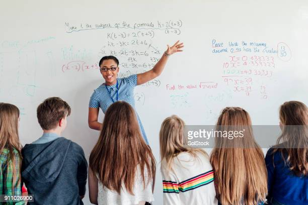 teacher giving a lesson - mathematics stock pictures, royalty-free photos & images