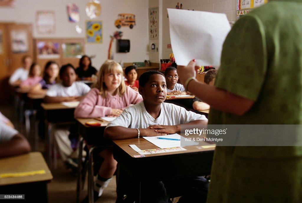 Teacher Going over Exam Instructions : Stock Photo