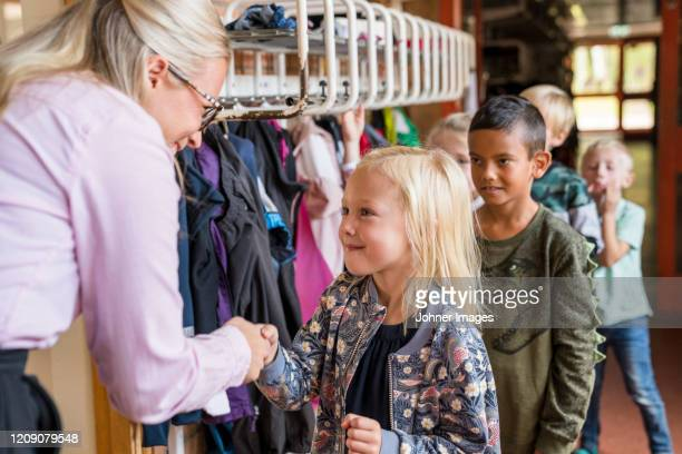 teacher greeting children - sweden stock pictures, royalty-free photos & images