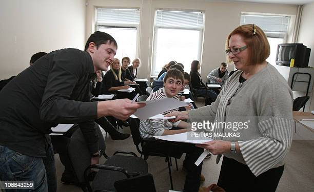 Teacher hand out papers at the European Humanities University on February 3, 2011 in Vilnius. Regarded as too Western and liberal by Belarussian...
