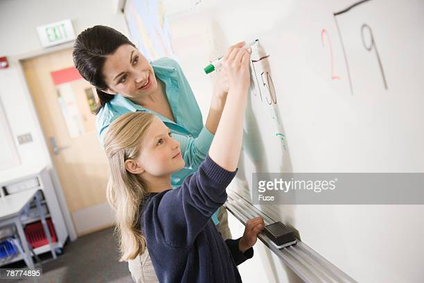 Teacher Helping Student Practice Division