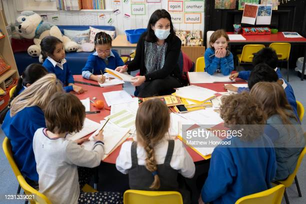 Teacher holds a creative writing class at Roath Park Primary School on February 23, 2021 in Cardiff, Wales. Children aged three to seven began a...