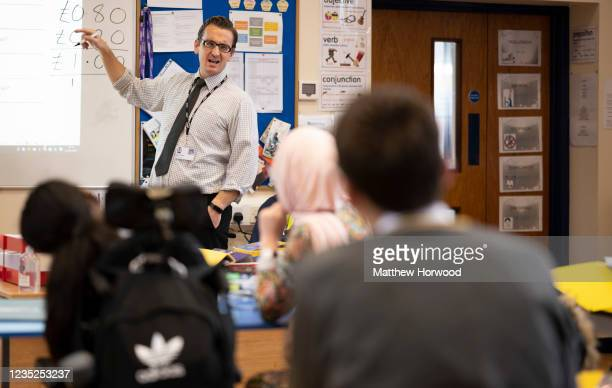 Teacher holds a maths class at Whitchurch High School on September 14, 2021 in Cardiff, Wales. All children aged 12 to 15 across the UK will be...