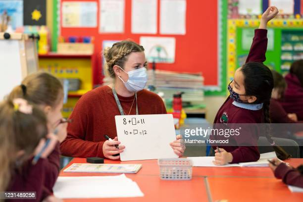 Teacher holds a maths lesson wearing a face mask at Glan-Yr-Afon primary school on March 3, 2021 in Cardiff, Wales. Children aged three to seven...