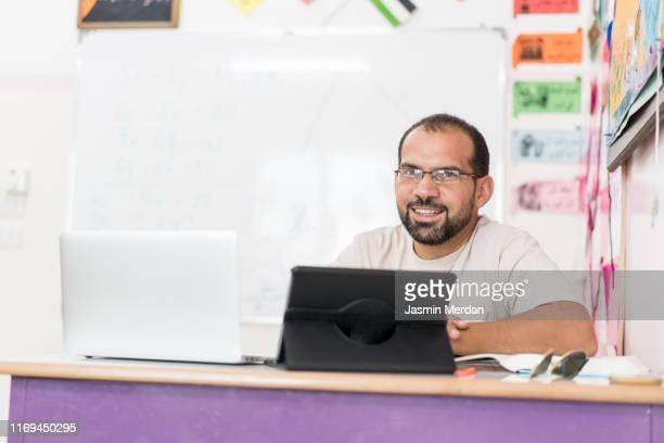 teacher in school classroom - jordanian workforce stock pictures, royalty-free photos & images