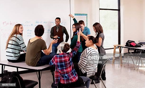 Teacher instructing a high school class.