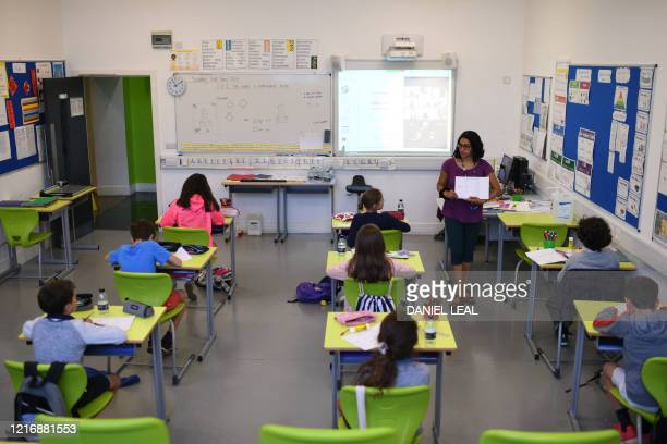 Teacher instructs Year 6 pupils in a classroom with other pupils participating by video conference at the College Francais Bilingue De Londres...