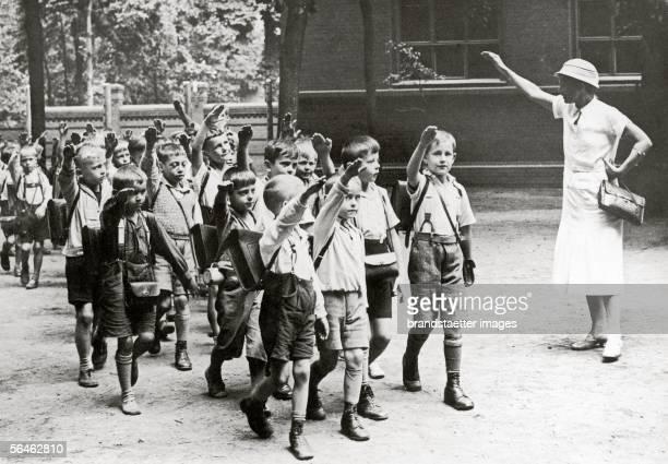 A teacher is seeing off her school children with the Hitler Gruss Photography Around 1933 [Eine Lehrerin verabschiedet ihre Schulkinder mit dem...