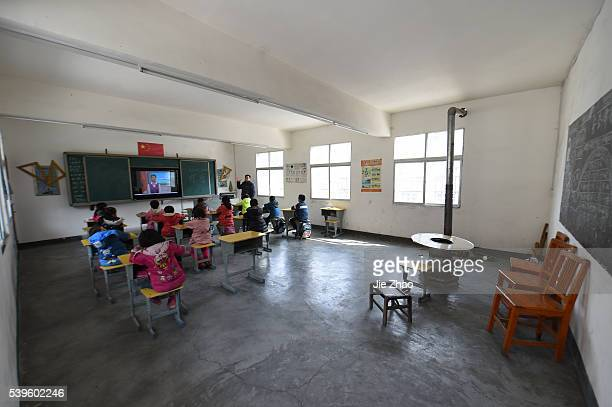 A teacher is teaching in the classroom at a primary school in Baokang Hubei province central ChinaEducation reform is also the hot topic in Chinese...