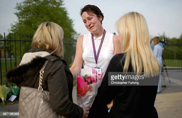 Teacher Jayne Sexton comforts students outside Corpus Christi Catholic College in Neville Road Leeds where a female teacher was fatally stabbed...