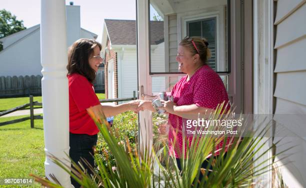 Teacher Karen Mallard who is running for the Democratic nomination in Virginia's 2nd Congressional District shakes Kelly Bleadingheiser's hand while...