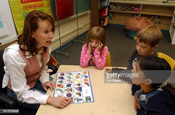 Teacher Kelly Inmann teaches reading skills to 7yearold students Makayla Fellows Lance Fisher and Destiny Aguilar at Clayton Elementary School in...