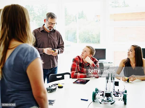 Teacher leading discussion in robotics class