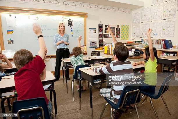 Teacher leading Elementary School Class