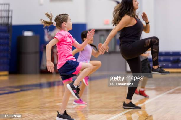pe teacher leads class - physical education stock pictures, royalty-free photos & images