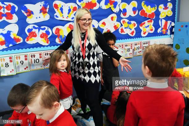 Teacher leads pupils in an activity during class at Clyde Primary School in Glasgow on February 22, 2021 as schools in Scotland started to reopen to...