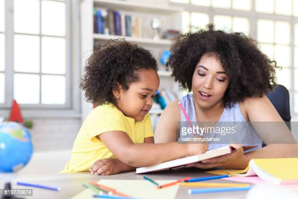 Teacher learning little girl