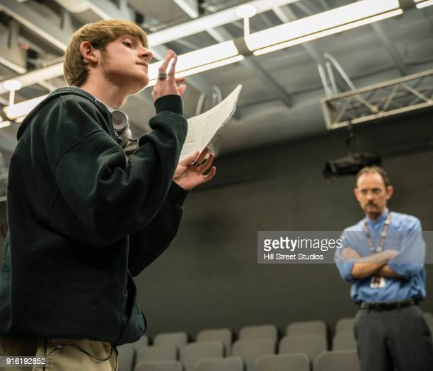 teacher listening to student reading script - actor stock pictures, royalty-free photos & images