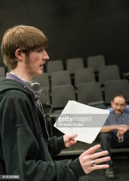 Teacher listening to student reading script