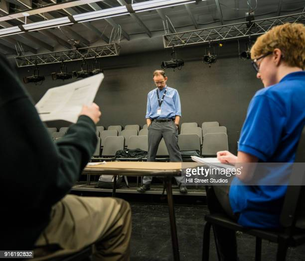teacher listening to students reading scripts - actor stock pictures, royalty-free photos & images