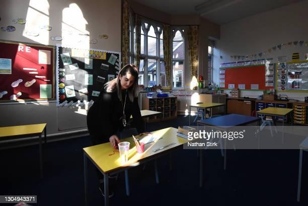 Teacher, Miss Galluzzo prepares a school desk at Astbury St Mary's Church of England Primary School on March 02, 2021 in Congleton, England....