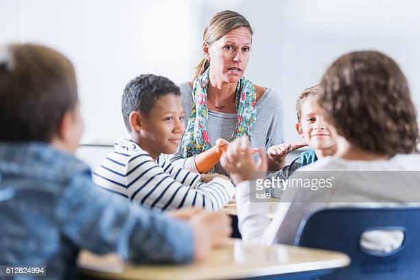 Teacher, multi-ethnic elementary school children, class